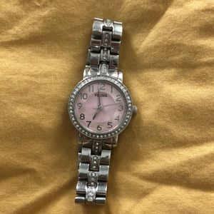 Fossil watch with light pink face